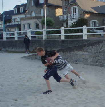 Playing American football on the beach